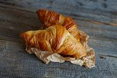 foto of crescent-shaped  - Original French croissants  is a buttery flaky viennoiserie bread roll named for its distinctive crescent shape - JPG