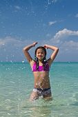 Girl Splashing In The Water At The Beach Of The Koh Ngai Island Thailand