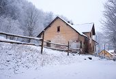 Old House Covered In Snow
