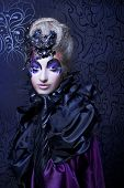 stock photo of evil queen  - Dark queen. Young woman in creative halloween image.
