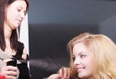 picture of hairspray  - Girl with blond wavy hair by hairdresser - JPG