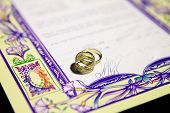 pic of rabbi  - wedding rings and Ketubah - a prenuptial agreement in jewish religious tradition