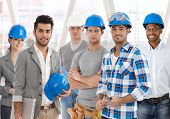 Group of diverse people from building industry: architects, managers, workers posing together for a