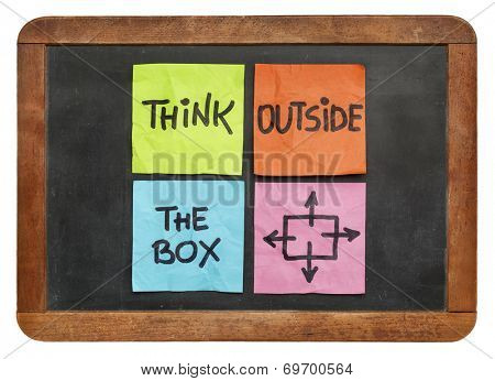 think outside the box concept - colorful sticky notes on a vintage slate blackboard  isolated on white
