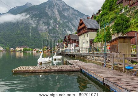 HALLSTATT, AUSTRIA - 21 JUNE 2014: Town square in Hallstatt, Austria. Hallstatt is historical village located in Austrian Alps at the Hallstatter lake and promoted by UNESCO World Heritage region.