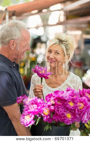 Smiling Charismatic Woman Holding Flowers