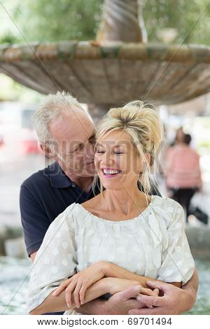 Romantic Middle-aged Man Nuzzling His Wife