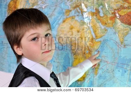The Boy Is Studying The Physical Map Of The World