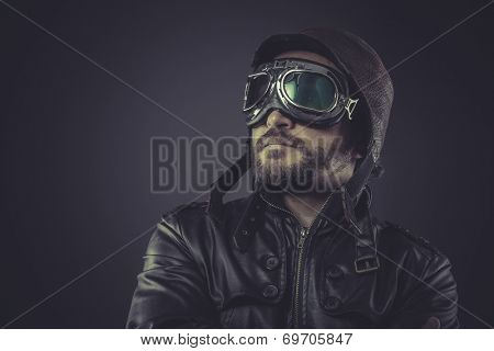 motivation pilot dressed in vintage style leather cap and goggles