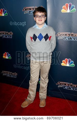 NEW YORK-AUG 6: Pianist Adrian Romoff attends the 'America's Got Talent' post show red carpet at Radio City Music Hall on August 6, 2014 in New York City.