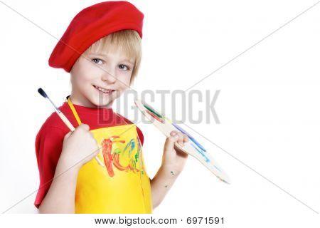Niño con cepillo y de artista paleta con varios colores