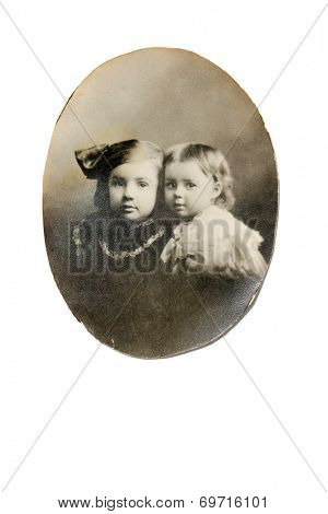 USA- CIRCA 1900s: An antique photo shows studio portrait of two children.