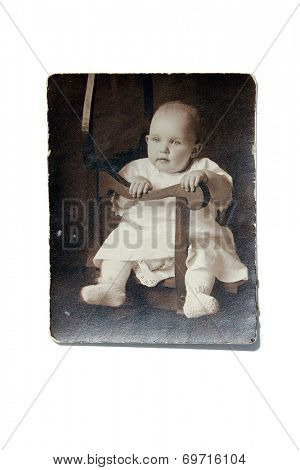 USA- CIRCA 1900s: An antique photo shows studio portrait of a baby girl posing for a portrait.