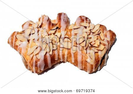 a Hot from the oven Fresh Baked Bear Claw Pastry covered in slivered Almonds and Sugar Frosting isolated on white with room for your text. Bear Claws are loved world wide for breakfast and snacks