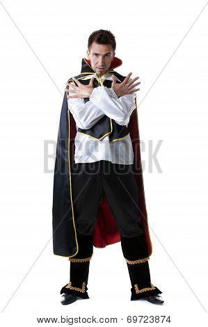 Pretentious man posing in costume of illusionist