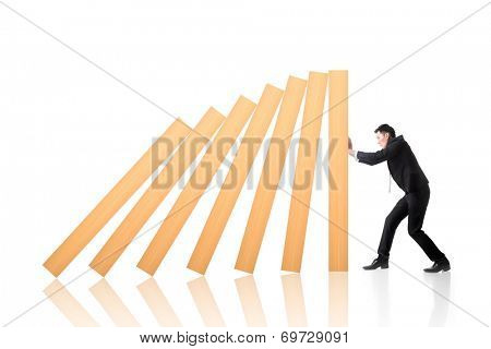Business concept of stop the domino effect.