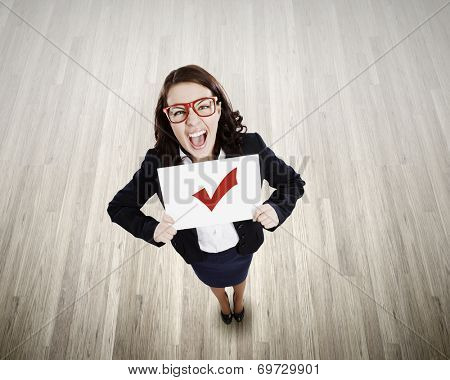 Top view of businesswoman holding white banner with red tick