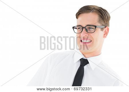 Geeky young hipster looking with disgust on white background