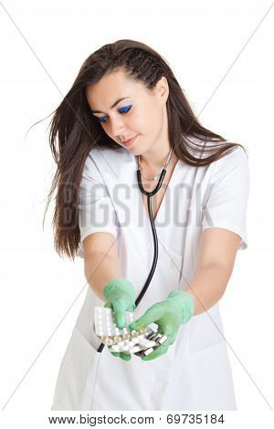 Woman Doctor With Pills In Hand.  Female Doctor Holding Many Pills In Her Hands