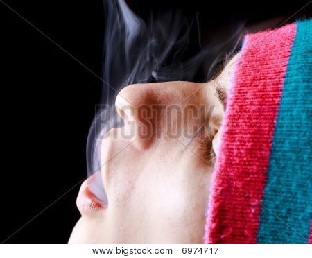 Man Blowing Smoke