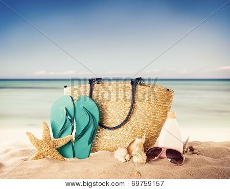 Summer concept with swimming accessories and blur sea on background
