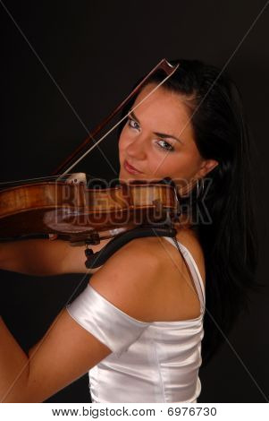 beautiful girl paying the violin