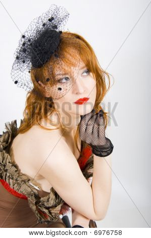 Glamour portrait of sexy retro woman in bleck net veil