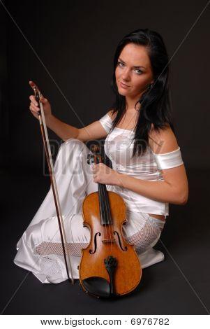 beautiful girl paying the violin