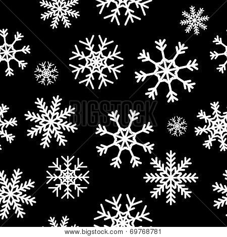 White snowflakes on black background