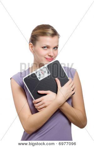 lächelnd young Woman holding eine Waage