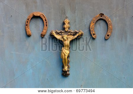 Suffering Of Jesus Christ And Two  Rusty Horseshoe On Blue Wooden Wall