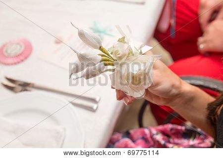 flowers on the boutonniere on the hand