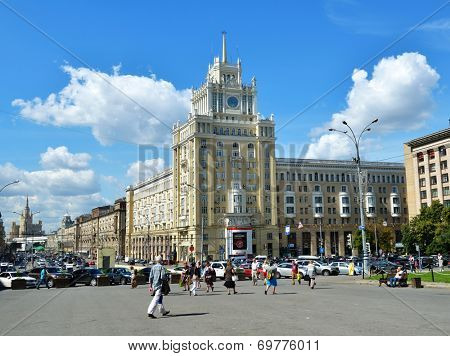 MOSCOW, RUSSIA - JULY 4, 2014: People on the Triumphal square in front of the hotel Peking. The hotel was opened in 1956, and every room here still has its own individual design