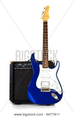 Electric Guitar Stand In Front Of Amplifier