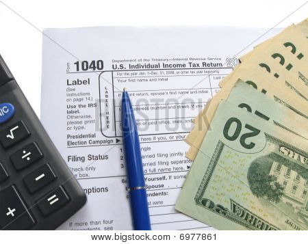 Individual tax return form 1040, calculator, pen