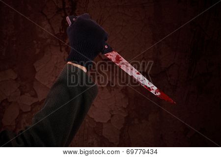 A Hand Holding Bloody Knife