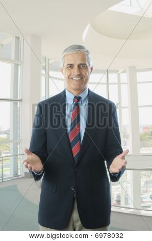 Middle Aged Businessman In Blue Blazer Hands Extended