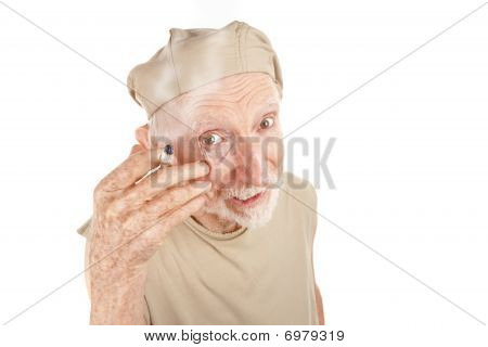 Ragged Senior Man With Cigarette