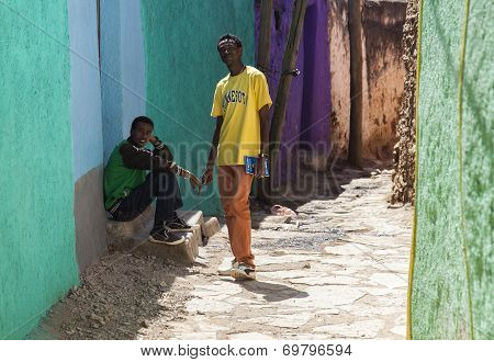 Harar, Ethiopia - December 24, 2013: Two Unidentified Young Men Posing In Typical Surroundings In An
