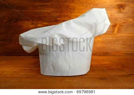 Chef's hat on wooden background