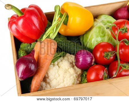 Fresh vegetables in wooden box on white background