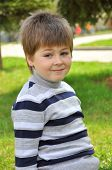 foto of 8-track  - Portrait of a boy in the park - JPG