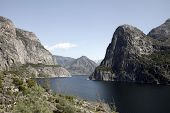 stock photo of gravity  - The manmade Hetch Hetchy Reservoir in Yosemite National Park provides water to the city of San Francisco through a gravity - JPG