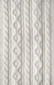 picture of knitting  - Knit texture of white wool knitted fabric with cable pattern as background - JPG