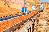 stock photo of open-pit mine  - open coal mining pit with heavy machinery