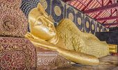 picture of recliner  - Reclining Buddha gold statue in temple of Thailand - JPG