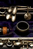 picture of clarinet  - Parts of a clarinet are stored in blue lined case.