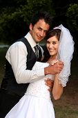 stock photo of wedding couple  - Beautiful wedding couple dancing on the lawn at their reception - JPG