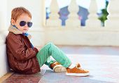 stock photo of bomber jacket  - cute stylish boy in leather jacket and gum shoes - JPG