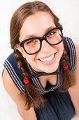 stock photo of goofy  - young goofy and nerdy girl looking at camera - JPG